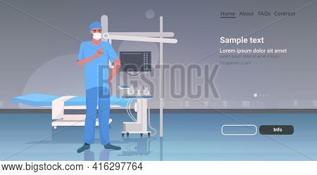 Male Doctor Surgeon In Protective Mask And Gloves Hospital Medical Clinic Worker In Uniform Medicine