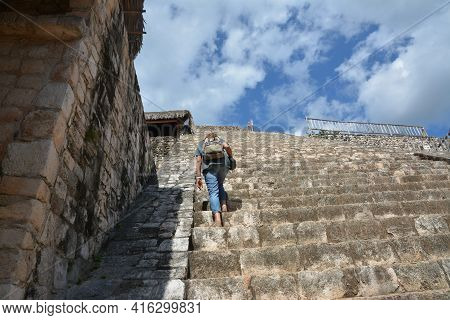 Woman Climb Up At Acropolis Of Mayan Archeological Site Of Ek Balam.  This Ancient Mayan Site Ek Bal