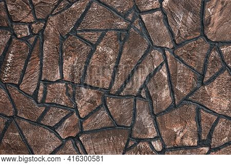 Brown Stone Wall With Irregular Mosaic Pattern Of Dark Seams