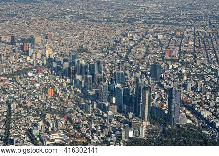 Aerial View Of Mexico City.  An Aerial View Of Paseo De La Reforma And  Skyscraperes Torre Mayor And