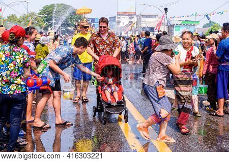 Chiang Mai, Thailand - April 13, 2019 : Thai People And Tourist Play Water Fighting Around Street On