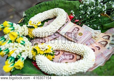 Thai Banknote 1000 Baht in Phan (tray with pedestal) with graland to make merit and to donate money to charity in Thai Traditional way.