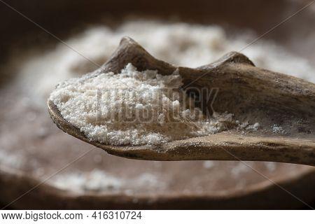 Closeup Spoonful Natural Sea Salt On Primitive Bone Spoon In Natural Light