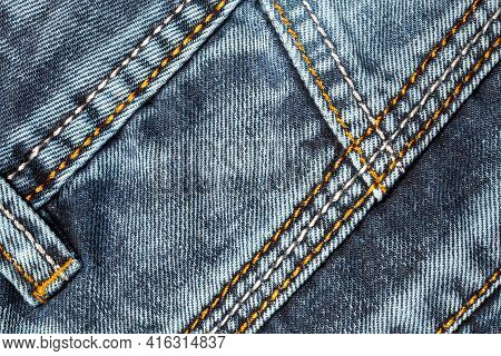 Jeans Background. Denim Fabric With Seams Close-up.