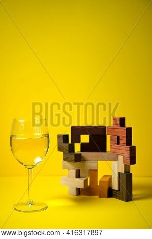 A Glass Of White Wine, On A Colored Background With An Abstract Design, A Non-standard Approach In A