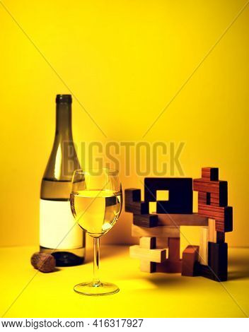 A Glass Of Wine On A Colored Background With An Abstract Installation Of Geometric Shapes. The Play