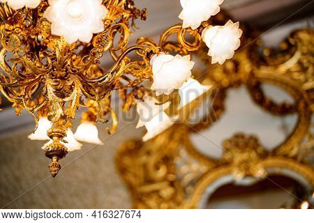 Large Golden Chandelier With Floral Shades And Floristic Style Bulbs. Close-up Of Shades And Floral