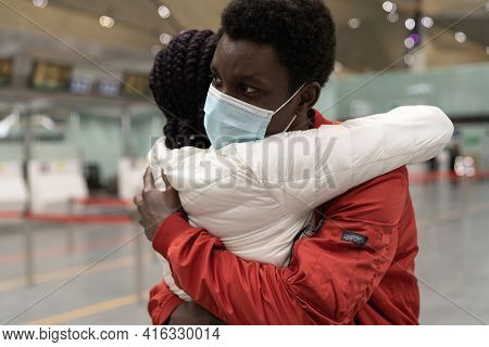 African American Couple Wear Medical Face Masks Hugging, Embrace Each Other Within The New Normality