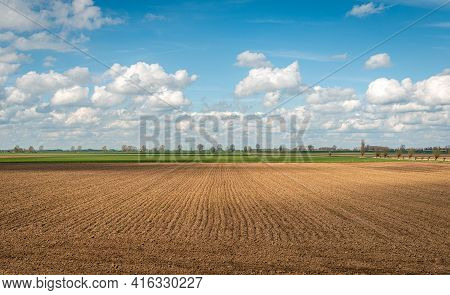 Freshly Plowed Field On A Cloudy Day. The Photo Was Taken At The Beginning Of The Spring Season In T