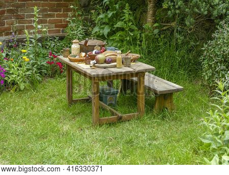 Idyllic Outdoor Scenery Including A Rural Wooden Table With Various Food On It