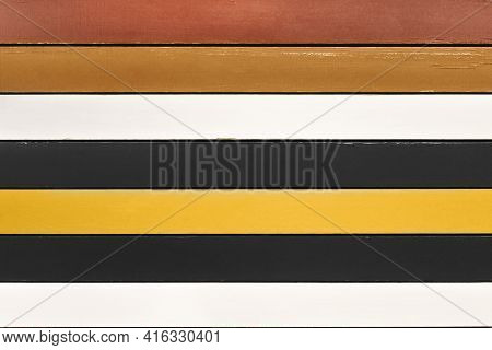 Multicolored Wooden Planks Background. Backdrop Made Of Brown, White, Black And Yellow Planks Arrang