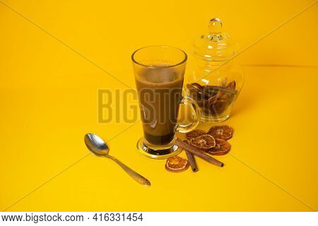 A Cup Of Aromatic Coffee With Spices On A Bright Colored Background. Ready For Advertising. Banner.