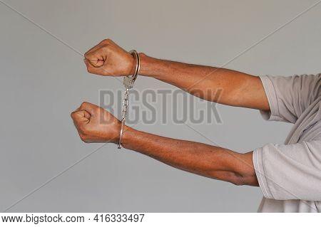 African American Man Handcuffs. Criminal African Hands Locked In Handcuffs