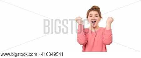 Cheerful Young Girl 12-14 Years Old Raising Her Fists With Smiling Delighted Face, Yes Gesture, Cele