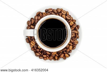 Cup Of Coffee With Coffee Beans On Saucer. Isolated On White. Top View.