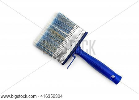 Blue Paintbrush On A White Background. Top View.