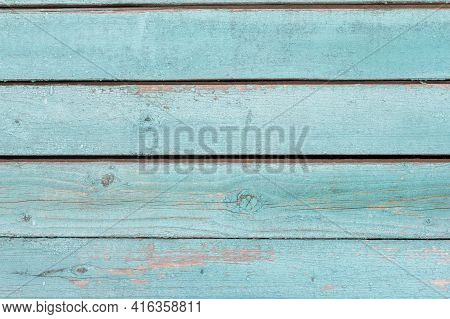 Old Wooden Wall Painted Blue, Weathered Wooden Background With Nails And Slits.