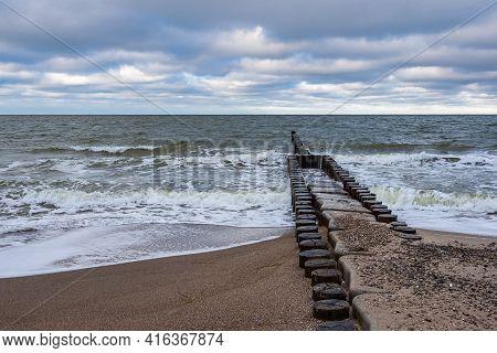 Groynes On Shore Of The Baltic Sea In Ahrenshoop, Germany.