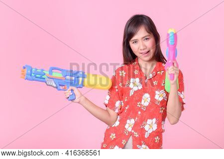A Beautiful Asian Woman Shows A Gesture While Holding A Plastic Water Gun During The Songkran Festiv