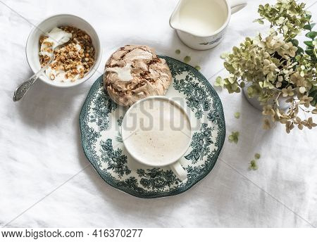 Cozy Homemade Breakfast - Greek Yogurt With Granola, Chocolate Meringue, Cappuccino On A Light Backg