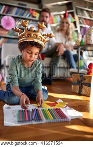 Happy caucasian couple with adopted afro american child celebrating birthday together
