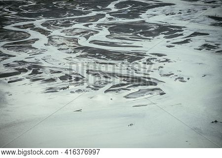 Atmospheric Monochrome Landscape With Many Channels Near Shallow Lake. Minimal Backdrop Of Gray Wate