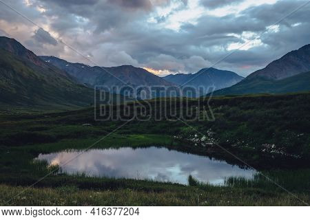 Scenic Landscape With Mountain Lake Under Sunset Cloudy Sky. Atmospheric Scenery With Lake Among Mou