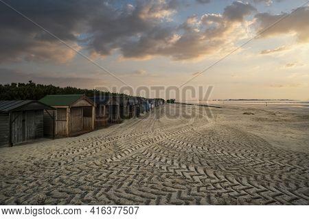 Beautiful Beach Coastal Landscape Image At Sunrise With Colorful Vibrant Sky