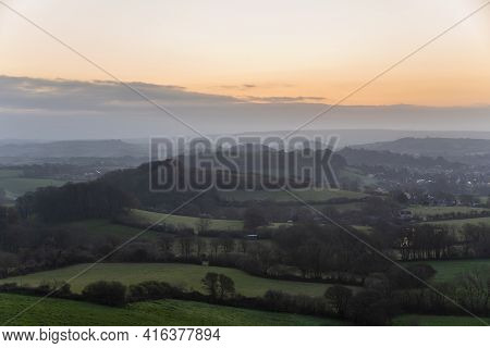 Stunning beautiful sunrise landscape image of Colmer\'s Hill in Dorset on a Spring morning