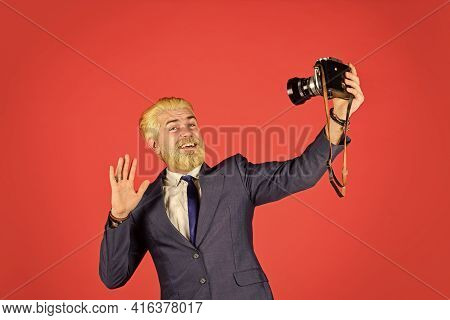 Man Cheerful Bearded Hipster Photographer. Photographer Eccentric Guy With Slr Camera. Classy And Ol