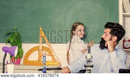 School Education. Study Hard. Following Example. Girl Pupil Study With Bearded Teacher. Studying Met