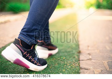 Low Macro Shot Showing Colorful Shoes Of Strong Independent Powerful Girl Going Into Sunlight While