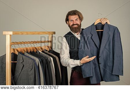 Bearded Man Collector Vintage Clothes Showing Formal Suit, Famous Brand Concept