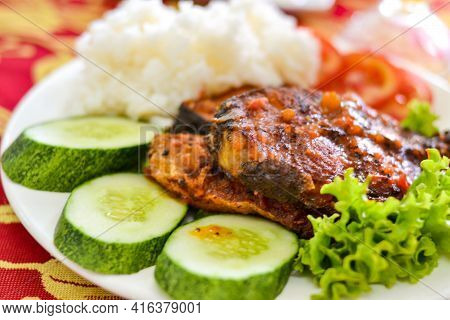 Com Tam - A Close-up Of Vietnamese Cuisine: Delicious Broken Rice With Fried Fish, Cucumbers, Salad.