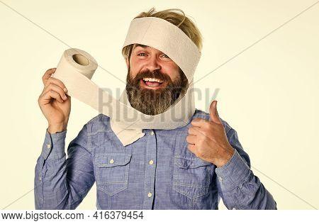 Coronavirus Toilet Paper Shortage. Essential Goods. Consumerism. Man Hold Toilet Paper. Hipster Guy