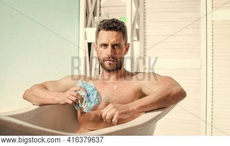 Sex And Relaxation Concept. Wash Off Foam With Water Carefully. Macho Naked In Bathtub. Macho Attrac