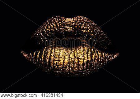 Abstract Gold Lips. Golden Lips Closeup. Gold Metal Art Lip. Beautiful Makeup. Golden Lip Gloss On B