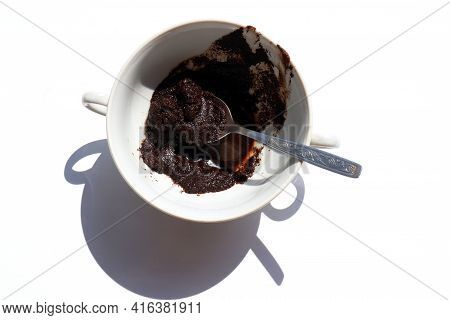 Spent Coffee In The Cup On White Background. Recycling Used Coffee Grounds In The Garden As Organic