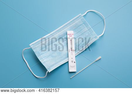 Rapid Coronavirus Test And A Medical Mask On The Blue Background. Negative Test Result By Using Rapi
