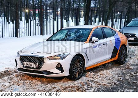 Moscow, Russia - January 24, 2021: Compact Executive Sedan Genesis G70 In The City Street.