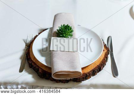 Wedding Table Setting With Blank Guest Card, Napkin, Succulent On Wooden Plate. Rustic Decor