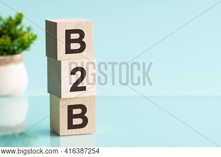 Three Wooden Cubes With Letters - B2b - Short For Business To Business, On Blue Table, Space For Tex
