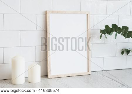 Vertical White Picture Frame Mockup, Candles, Eucalyptus. Modern Home Interior, Scandinavian Style.