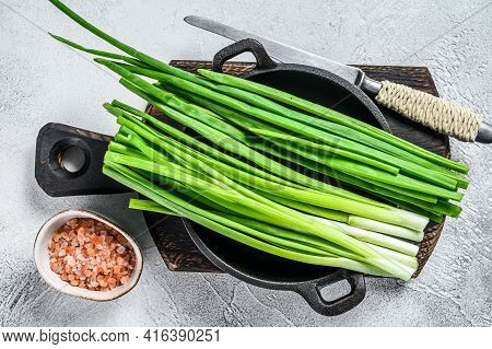 Raw Green Onions Chives. White Background. Top View