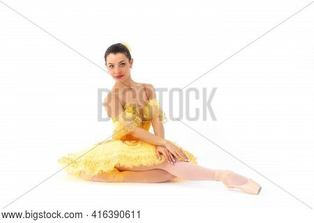 Young Modern Ballet Dancer In Yellow Dress Isolated On White Background