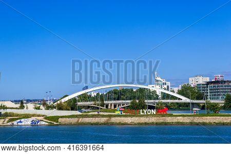 Lyon, France - August 22, 2019: The Pont Raymond Barre Bridge Over Rhone River And Slogan Of Lyon Ci