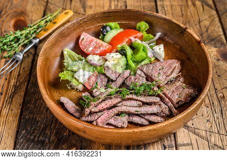Bbq Beef Meat Chop Sirloin Steak On A Wooden Plate With Vegetable Salad. Wooden Background. Top View