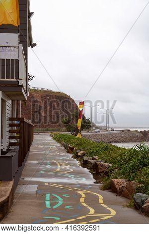 Yeppoon, Queensland, Australia - April 2021: Surf Lifesaving Club On The Beach On A Wet Rainy And Wi