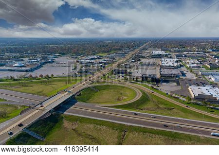 Aerial View Of Highway Interchange Freeway Interchange With Traffic On A Bridge And Streets Roads An