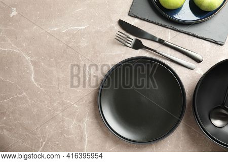 Set Of Clean Dishware On Grey Table, Flat Lay. Space For Text